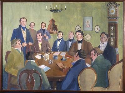 Artikkelin kuvituskuvana akvarelli vuodelta 1932. Maalaus kuvaa Suomalaisen Kirjallisuuden Seuran perustamiskokousta. Kuvassa miehiä istumassa pöydän ympärillä.